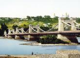 Эпоху стационарных киевских мостов в 1855 году открыл Николаевский Цепной мост, который по длине и наличию конструкций стал единственным в мире шестипролетным переходом через водное пространство