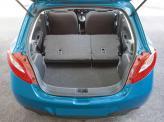 Путем складывания задних сидений объем багажника увеличивается с 250 до 787 л