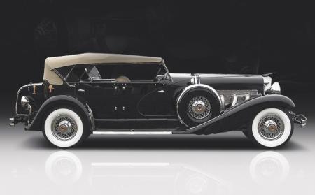 В начале прошлого века мощные автомобили можно было отличить по размерам капота. Так под капотом этого Duesenberg J скрывается рядный 8-цилиндровый двигатель длиной 1,2 м, развивающий 265 л. с. (рабочий объем 6,9 л)